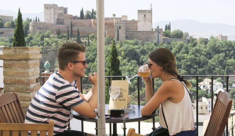 Tourists drink beer in Granada.